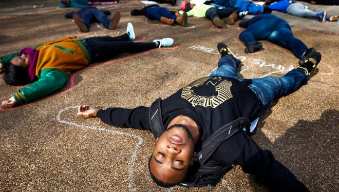A student takes part in a protest on Christian Brothers University campus on Dec. 9, 2014, in Memphis.