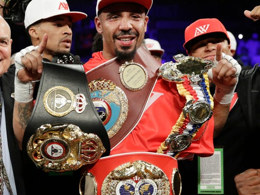 FILE - In this June 17, 2017, file photo, Andre Ward celebrates after defeating Sergey Kovalev in a light heavyweight championship boxing match in Las Vegas.  Ward is retiring from boxing with an undefeated record because he no longer has the desire to fight, according to a statement on his website Thursday, Sept. 21, 2017.  (AP Photo/John Locher, File)