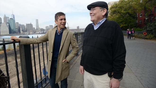 Hector Hernandez, of Brooklyn, N.Y., walks with his father, Gaston Hernandez, along the Brooklyn Heights Promenade. He plans to take his parents to work to show them what he does as a senior relationship manager at LinkedIn.