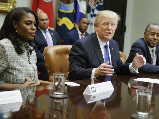 President Donald Trump, center, is flanked by White