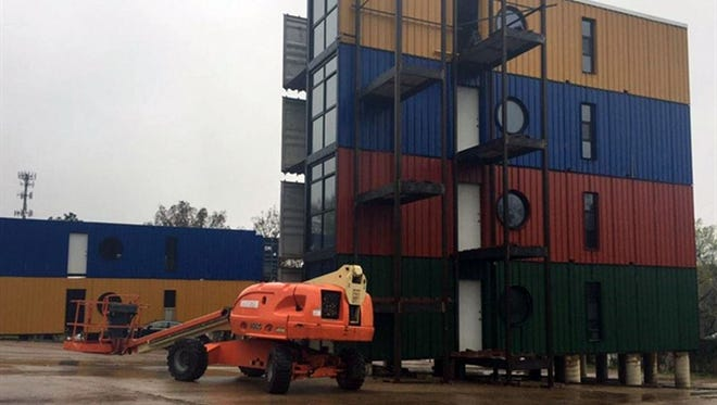 An apartment complex built of recycled shipping containers and called Cube Square is in the making in Huntsville, Texas, near Same Houston State University.