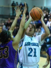 Navajo Prep's Harlei Haceesa takes a shot against Kirtland Central on Jan. 14 at the Eagles Nest in Farmington.
