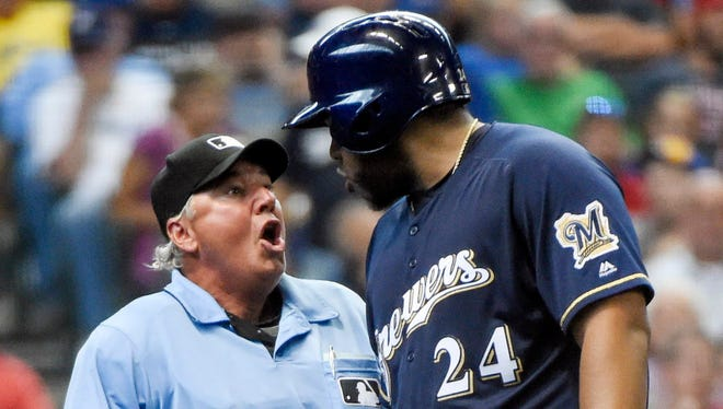 The Brewers' Jesus Aguilar had a recent discussion about the strike zone with home-plate umpire Tom Hallion.