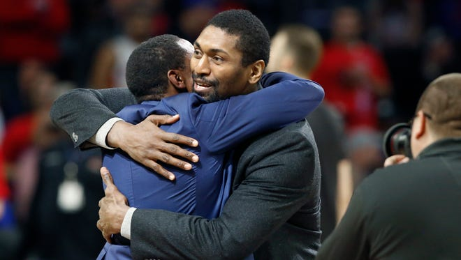 Former Detroit Pistons guard Isiah Thomas, left, is hugged by Los Angeles Lakers forward Metta World Peace during halftime Wednesday, Feb. 8, 2017, in Auburn Hills.