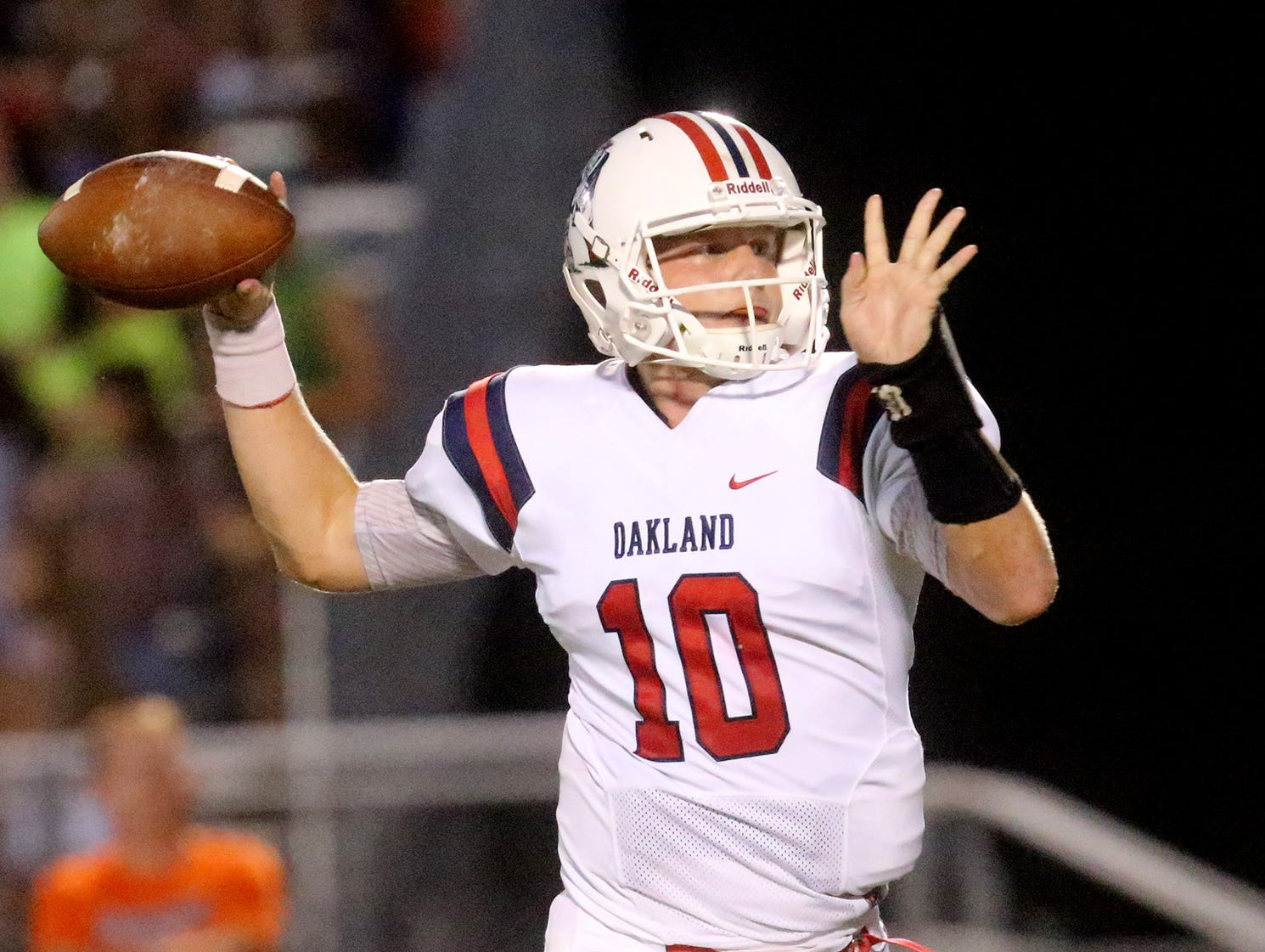 Oakland's quarterback Brendon Matthews (10) drops back to pass during the game against Blackman on Friday, Sept. 16, 2016, at Blackman.