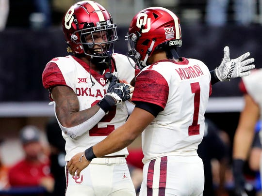 Dec 1, 2018; Arlington, TX, USA; Oklahoma Sooners wide receiver CeeDee Lamb (2) and quarterback Kyler Murray (1) celebrate a touchdown during the game against the Texas Longhorns in the Big 12 Championship game at AT&T Stadium. Mandatory Credit: Kevin Jairaj-USA TODAY Sports