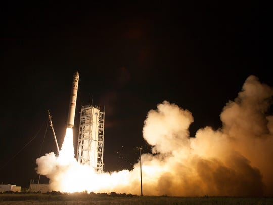 An unmanned Minotaur rocket launches NASA's robotic explorer, the LADEE spacecraft, charged with studying the lunar atmosphere and dust to the moon from NASA's Wallops Flight Facility.