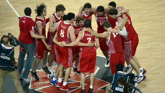 The Russian basketball team celebrates a victory in 2012.