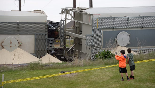 Emergency crews from across Northern Colorado responded to a train derailment in Timnath, Sunday, May 15, 2016.