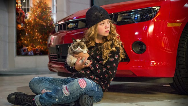 """Megan Charpentier with Tardar Sauce, better known as Grumpy Cat, in the new Lifetime movie, """"Grumpy Cat's Worst Christmas Ever."""""""