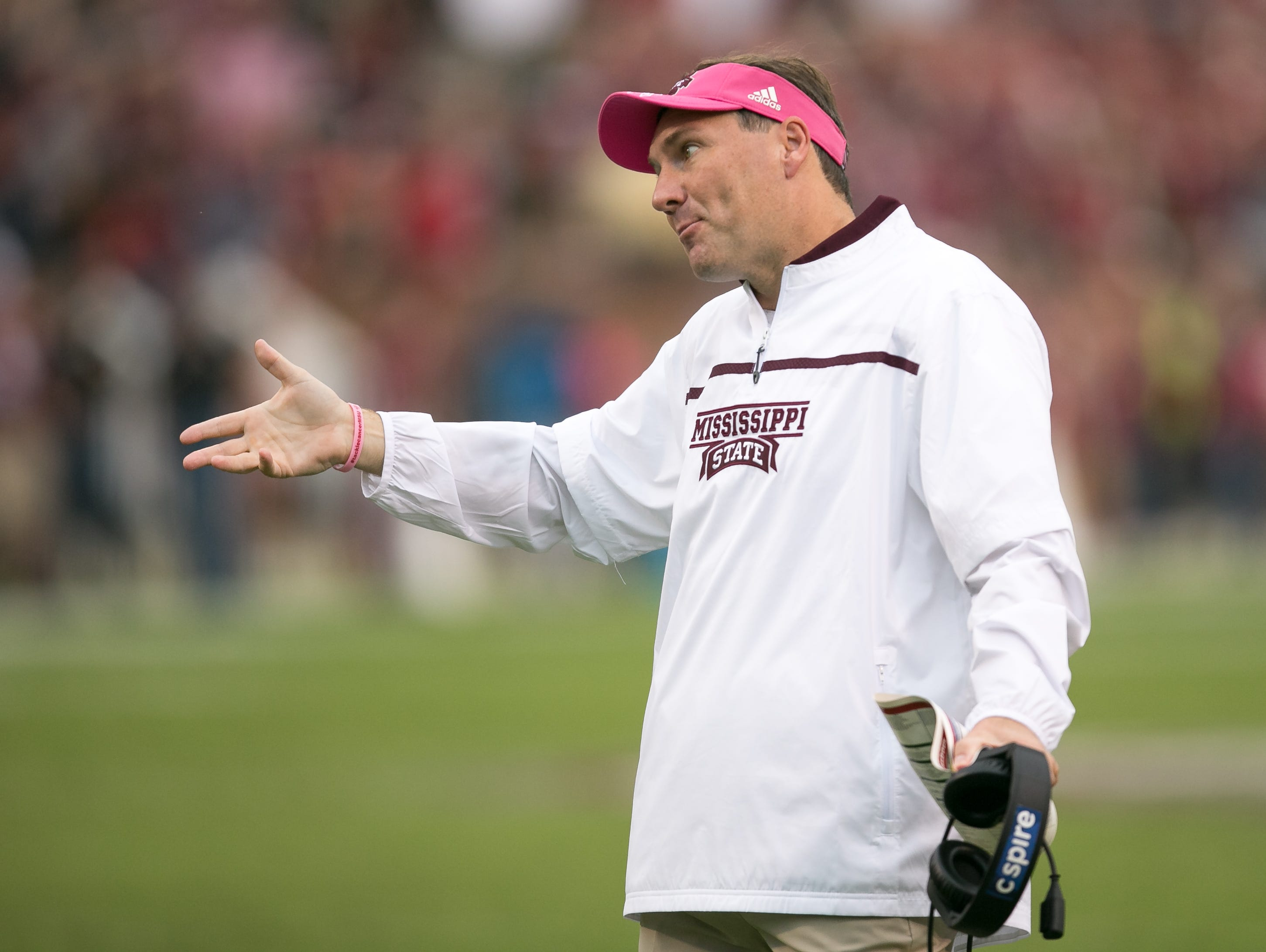 MSU head coach Dan Mullen talks to an official following an unsportsmanlike conduct penalty against the Bulldogs. Mississippi State played Troy in a college football game on Saturday, October 10, 2015 at Davis Wade Stadium in Starkville. Photo by Keith Warren (Mandatory Photo Credit)