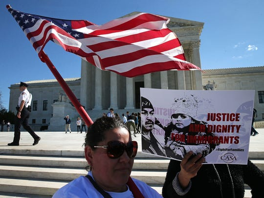 Pro-immigration protesters demonstrate at the Supreme Court last year to show support for President Barack Obama's anti-deportation efforts. The high court may get the last word on President Trump's travel ban.