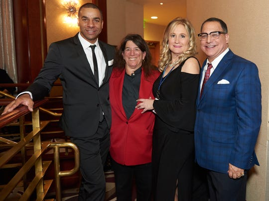 From left, MC Bryan Gallo, Well in the Desert President Arlene Rosenthal, event chair Darci Daniels, and MC Patrick Evans.