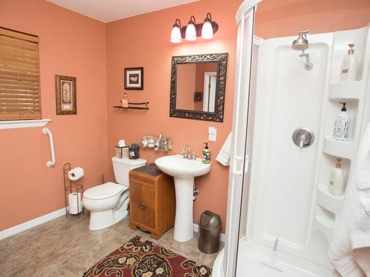 The bathroom of Clara Brosnaham Reeves' Airbnb cottage behind her house in Pensacola is pictured Wednesday, Jan. 10, 2018.