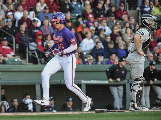 Clemson freshman Bryce Teodosio(31) scores by catcher South Carolina junior Hunter Taylor during the bottom of the fourth inning on Saturday at Fluor Field in Greenville.