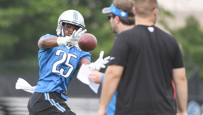 Running back Theo Riddick readies for a reception during drills.