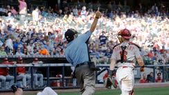 Home plate umpire James Hoye ejects Alfredo Simon after