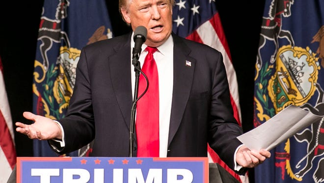 Republican Presidential Candidate Donald J. Trump speaks during his rally at the Pennsylvania Farm Show Complex & Expo Center in Harrisburg Thursday. Amanda J. Cain photo