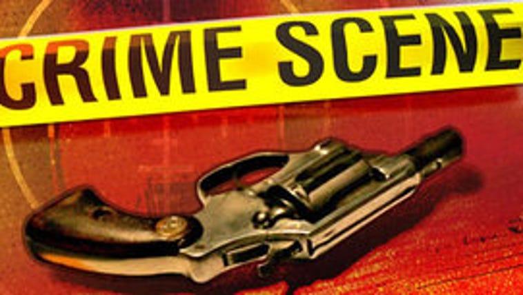 Handgun and crime scene tape