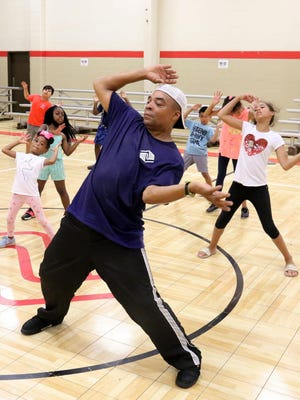 Fort Smith Boys & Girls Club Dance and Fitness instructor Eric Williams leads a dance class, Monday, June 29, 2020, at Jeffrey Boys and Girls Club as one of the summer programs at each club. Because of COVID-19 safeguards that include social distancing and related health restrictions, only 50 participants attend the club each day.