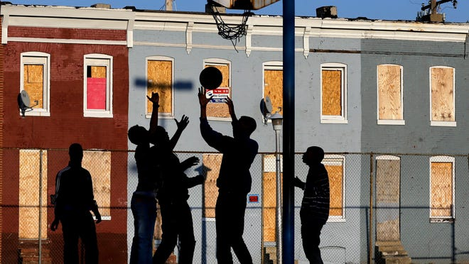 Residents play basketball in one of Baltimore's neighborhoods.