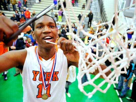 William Penn's Davante Jackson cuts down part of the net after the Bearcats beat South Western, 57-44, to win the YAIAA boys' tournament title Friday night. (Daily Record/Sunday News -- Chris Dunn)