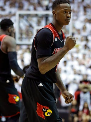 Louisville guard Terry Rozier clinches his fist late in the second half of an NCAA college basketball game against Cincinnati, Saturday, Feb. 22, 2014, in Cincinnati. Rozier scored 11 points in the game won by Louisville 58-57.