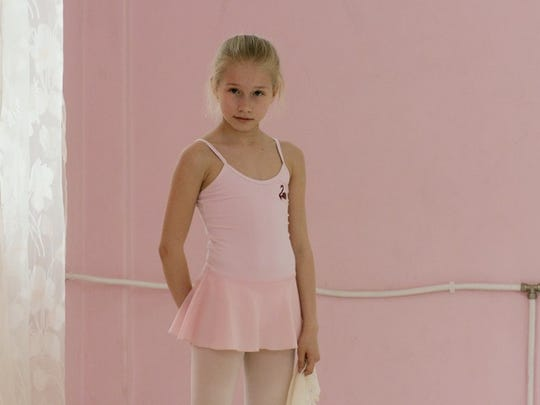 "An image from Rineke Dijkstra's video installation ""Marianna (The Fairy Doll)"" (2014)."