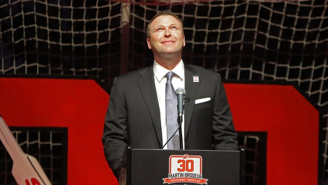 Former New Jersey Devils goaltender Martin Brodeur looks up and listens to an ovation from his fans as he participates in a ceremony to honor his career as a NJ Devil and retire his number.
