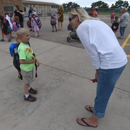Fort Collins resident Karen Shadowen talks with her grandson, Timnath Elementary Schoool kindergartner Anthony Parsons, 5, on Friday in Timnath. Friday was the last day of Poudre School District's early release schedule this year.