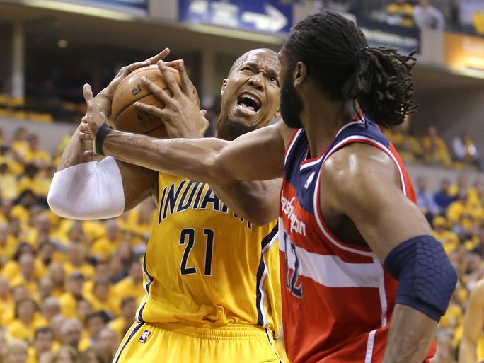 Pacers forward David West goes to the basket against Washington Wizards forward Nene Hilario during the first half of action. Indiana Pacers play the Washington Wizards in game 1 on the Eastern Conference Semifinals Monday, May 5, 2014, evening at Bankers Life Fieldhouse.