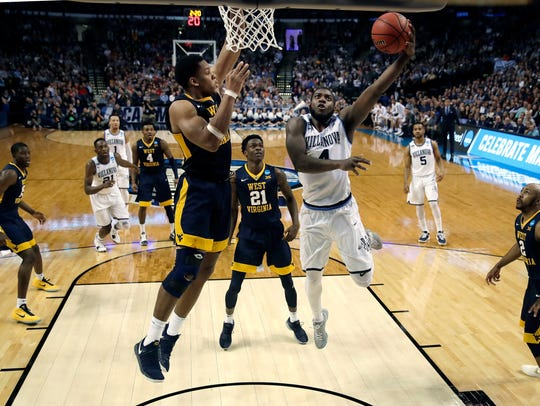 Villanova's Eric Paschall, right, drives against West