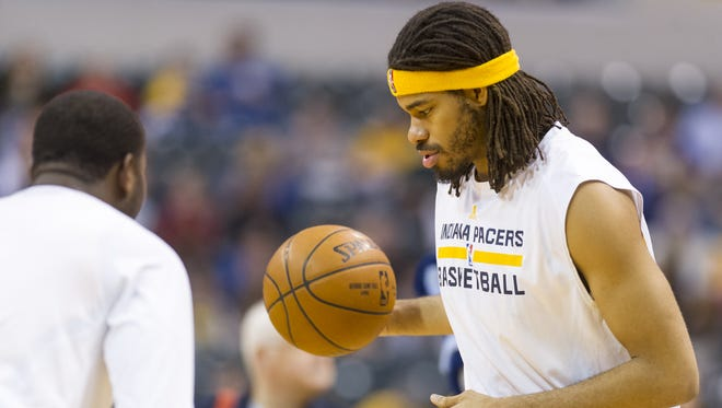 Indiana Pacers forward Chris Copeland (22) warms up on the court during the pre-game activities of an NBA basketball game, Friday, April 3, 2015, in Indianapolis.