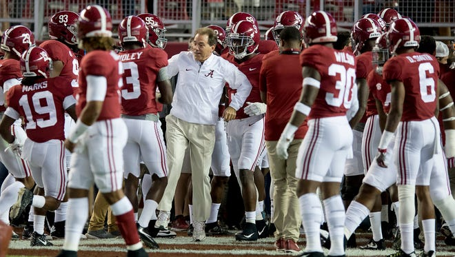 Alabama head coach Nick Saban with his team as they prepare to take the field for warm ups before the LSU game at Bryant Denny Stadium in Tuscaloosa, Ala. on Saturday November 4, 2017. (Mickey Welsh / Montgomery Advertiser)