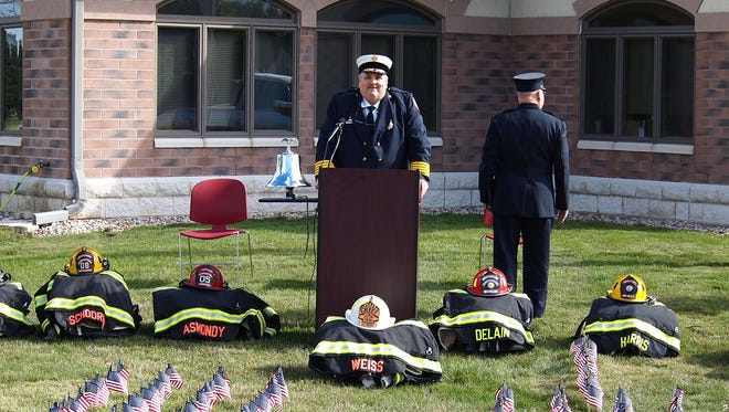 """Former Germantown Fire Chief Gary Weiss speaks at a remembrance ceremony on Sept. 11, 2015, in honor of the fallen New York Fire Department firefighters. Weiss resigned on March 19 after facing accusations of """"inappropriate behavior."""""""