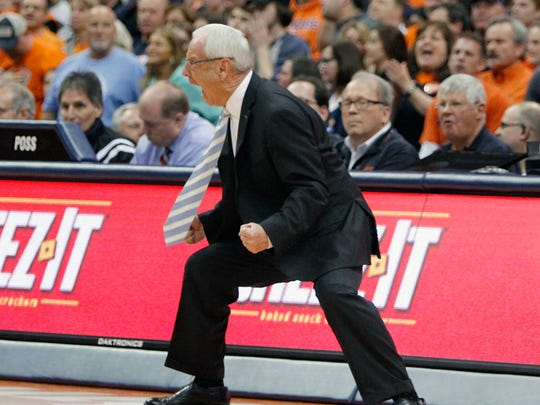 North Carolina head coach Roy Williams yells to his players during the second half of an NCAA college basketball game against Syracuse in Syracuse, N.Y., Wednesday, Feb. 21, 2018. North Carolina won 78-74. (AP Photo/Nick Lisi)