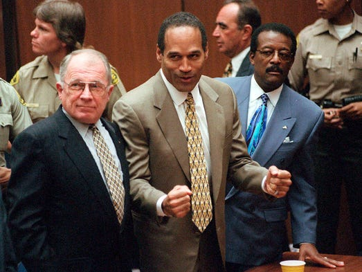 <p>Defense attorney F. Lee Bailey, left, defendant O.J. Simpson and defense attorney Johnnie Cochran react as a jury finds Simpson not guilty of murdering his ex-wife, Nicole Brown Simpson, and her friend Ron Goldman on Oct. 3, 1995, in Los Angeles.</p>