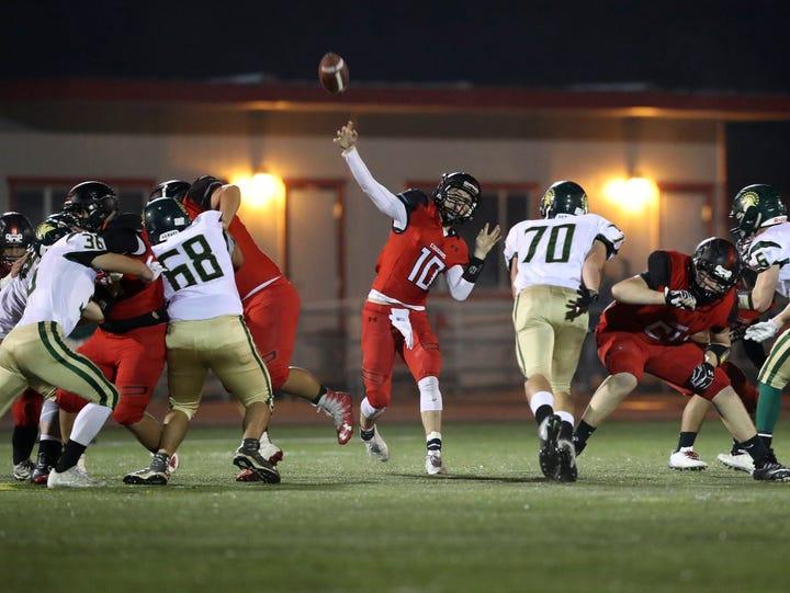 Foothill quarterback Jayden Gordon (center) throws
