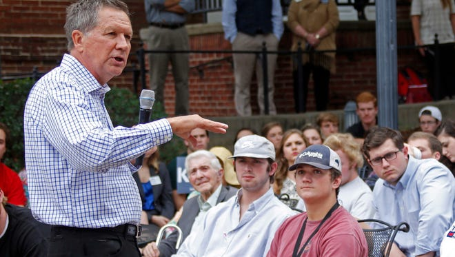 Ohio Gov. John Kasich, a Republican candidate for president, speaks with students Wednesday at Mississippi College in Clinton.