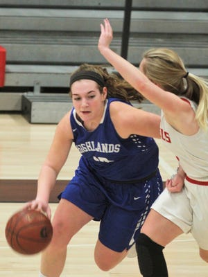 Highlands junior Zoie Barth drives against Dixie Heights senior Caroline Buddenburg during a girls basketball game featuring Highlands at Dixie Heights Feb. 2, 2018 at Dixie Heights HS, Edgewood. Both teams were 17-6 on the season going into the game.