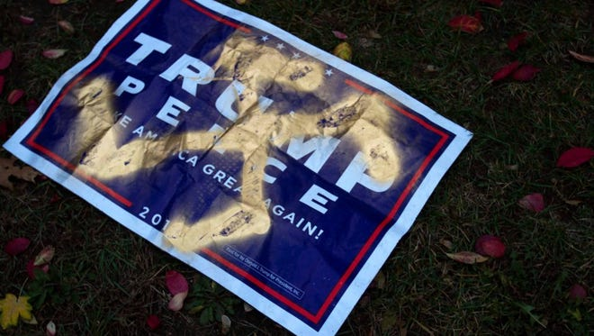 A Trump-Pence sign was marked with a swastika and found near the UVM Hillel Wednesday, Nov. 9, 2016, the day after Republican Donald Trump won the presidential election.