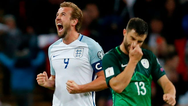 England's striker Harry Kane  celebrates a 1-0 victory over Slovenia at Wembley Stadium in London.