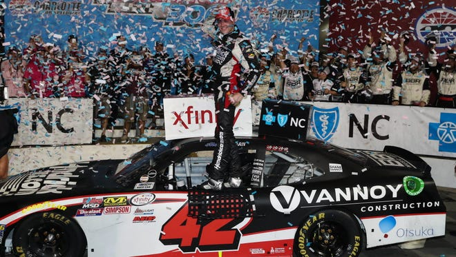 Xfinity Series driver Alex Bowman (42) celebrates in victory lane after the Drive for the Cure 300 at Charlotte Motor Speedway.