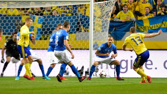 Sweden's Jakob Johansson (13) scores a goal in a 1-0 win over Italy in a World Cup playoff at Friends Arena in Stockholm, Sweden.