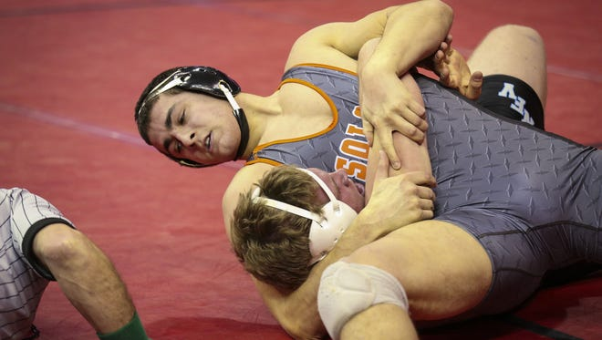 Solon's Lance Evans, top, is headed to Iowa after claiming the Class 2-A state title at 220 pounds as a senior.