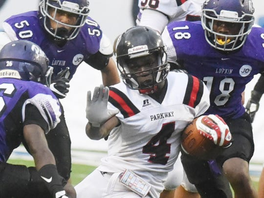Parkway's E.J. Williams tries to get away from Lufkin's defense during the Battle on the Border Saturday at Independence Stadium.