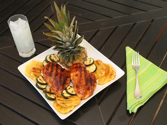 Grilled Hawaiian chicken with grilled pineapple and zucchini by Robin Miller at her home in Scottsdale. on May 18, 2017.