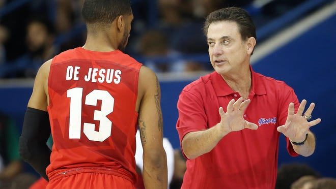 Louisville coach Rick Pitino talks to Puerto Rico guard Jearrell De Jesus during the team's opening contest at the 2015 Pan Am Games.