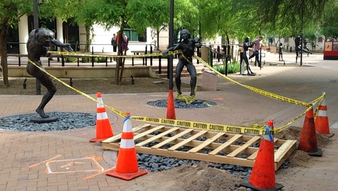 A statue was removed from outside the Herberger Theater in Phoenix after officials found it had been damaged.