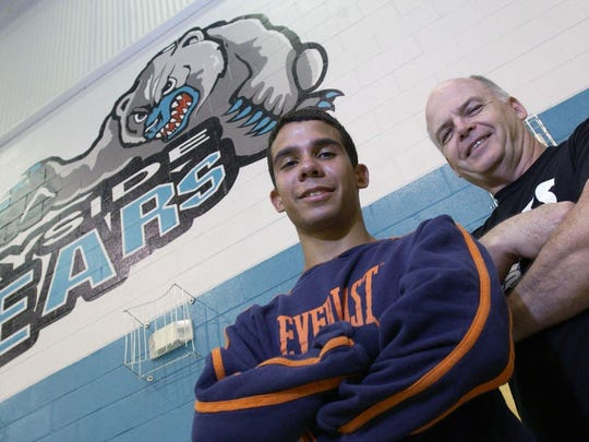 Bayside High wrestling coach Pat O'Bryan oses in the gym with wrestler Chris Matos in 2003.